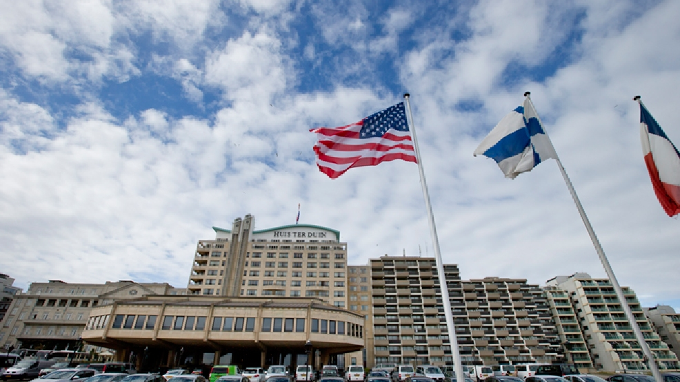 The U.S. flag flies outside Hotel Huis ter Duin, the hotel where President Barack Obama stayed Monday night, in Noordwijk, western Netherlands, Wednesday March 26, 2014. (AP Photo/Peter Dejong)