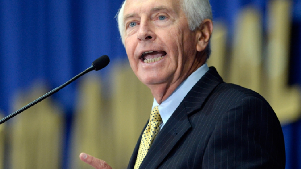 FILE - In an Aug. 22, 2013 file photo, Kentucky Gov. Steve Beshear addresses the audience at the 50th annual Kentucky Country Ham Breakfast, at the Kentucky State Fairgrounds in Louisville, Ky. Beshear on Tuesday, March 4, 2014 said that the state will hire outside attorneys to appeal a judge's decision granting legal recognition to same-sex couples married in other states and countries after the attorney general announced that he would not pursue the case further. (AP Photo/Timothy D. Easley, File)