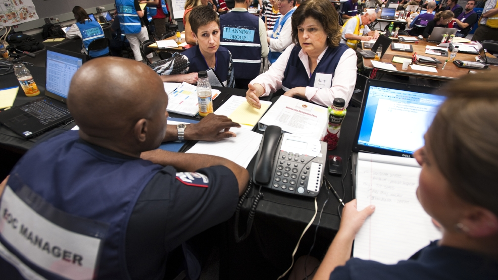 In this May 26, 2010 photo released by University of Wisconsin-Madison, more than 75 designated staff, participate in a full-scale campus emergency response exercise at an Emergency Operation Center (EOC) at the University of Wisconsin-Madison in Madison, Wis. A fake bomb will be set off in or around Camp Randall stadium next week, as part of an emergency-response simulation that's one of the largest the state has ever seen. The exercise Thursday, July 17, 2014 near downtown Madison will involve more than 400 people from 20 agencies, and will test how well-prepared police, hospitals and first-responders are for a mass-casualty occurrence. (AP Photo/University of Wisconsin-Madison)
