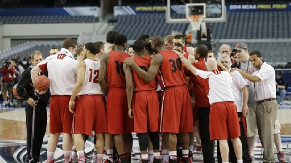 Wisconsin huddles during practice for their NCAA Final Four tournament college basketball semifinal game Friday, April 4, 2014, in Dallas. Wisconsin plays Kentucky on Saturday, April 5, 2014. (AP Photo/Eric Gay)