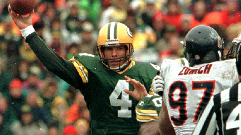 Green Bay Packers quarterback Brett Favre (4) throws a pass past Chicago Bears' Chris Zorich (97) in a light snowfall during the second quarter Sunday, Nov. 12, 1995, in Green Bay, Wis. Favre threw five touchdown passes in the Packers 35-28 win. Favre was 25 of 33 for 336 yards. (AP Photo/Morry Gash)