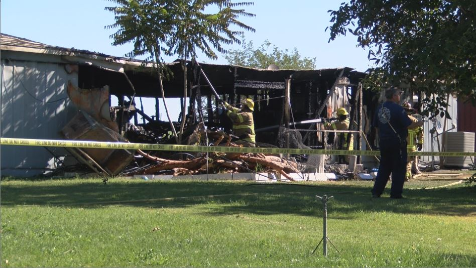Dad and 2 kids still in critical condition after mobile home fire