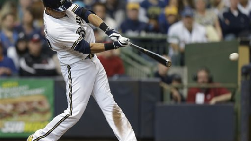 Milwaukee Brewers' Aramis Ramirez hits a two-RBI double against the Atlanta Braves in the fourth inning of an opening day baseball game Monday, March 31, 2014, in Milwaukee. (AP Photo/Jeffrey Phelps)