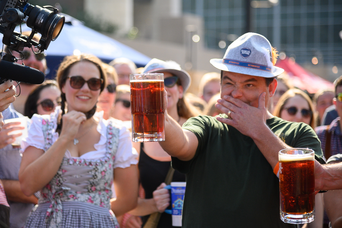 Nick Rauen steadies his hand before winning the 4 PM Sam Adams Stein Hoist Competition on Saturday. / Image: Phil Armstrong // Published: 9.22.19