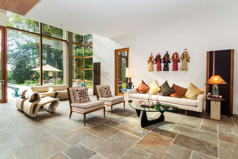 Designed by celebrated architect, Mark McInturff, FAIA., this inspiring modern home combines architectural details that blur pragmatic lines with a level of artistry scarcely found in our region. Boasting approximately 6,000 square feet of warm, open living spaces made of natural stone and wood materials throughout, one feels transported to a relaxing sun-filled retreat. It is a masterpiece, located in one of McLean, Virginia's most coveted neighborhoods. (Image: Courtesy Contemporary Listings)