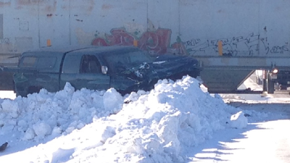 A man suffered non-life threatening injuries after his pickup truck collided with a train in Calumet County, Tuesday, Jan. 28, 2014. (WLUK/Chris Bourassa)