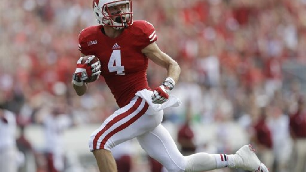 Wisconsin's Jared Abbrederis (4) catches a 65-yard touchdown pass during the second half of an NCAA college football game against Massachusetts Saturday, Aug. 31, 2013, in Madison, Wis. Wisconsin won 45-0. (AP Photo/Morry Gash)