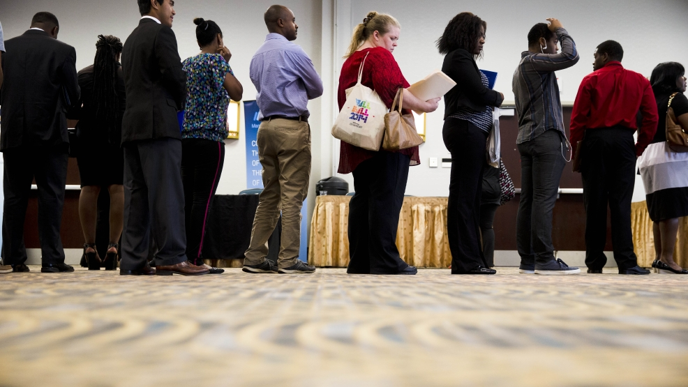 In this June 23, 2014 photo, job seekers wait in line to meet with recruiters during a job fair in Philadelphia. (AP Photo/Matt Rourke)