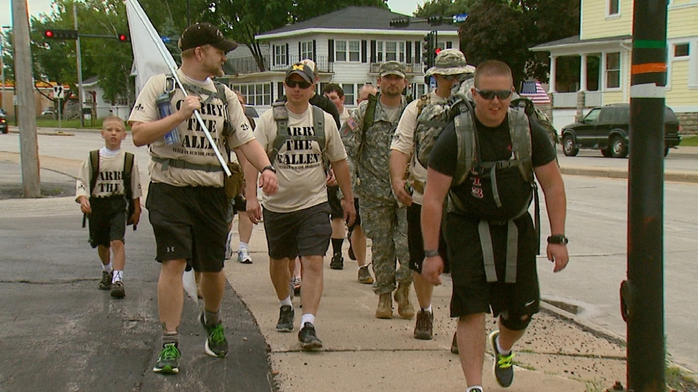 Dozens of people walk for 12 hours to honor military men and women with PTSD