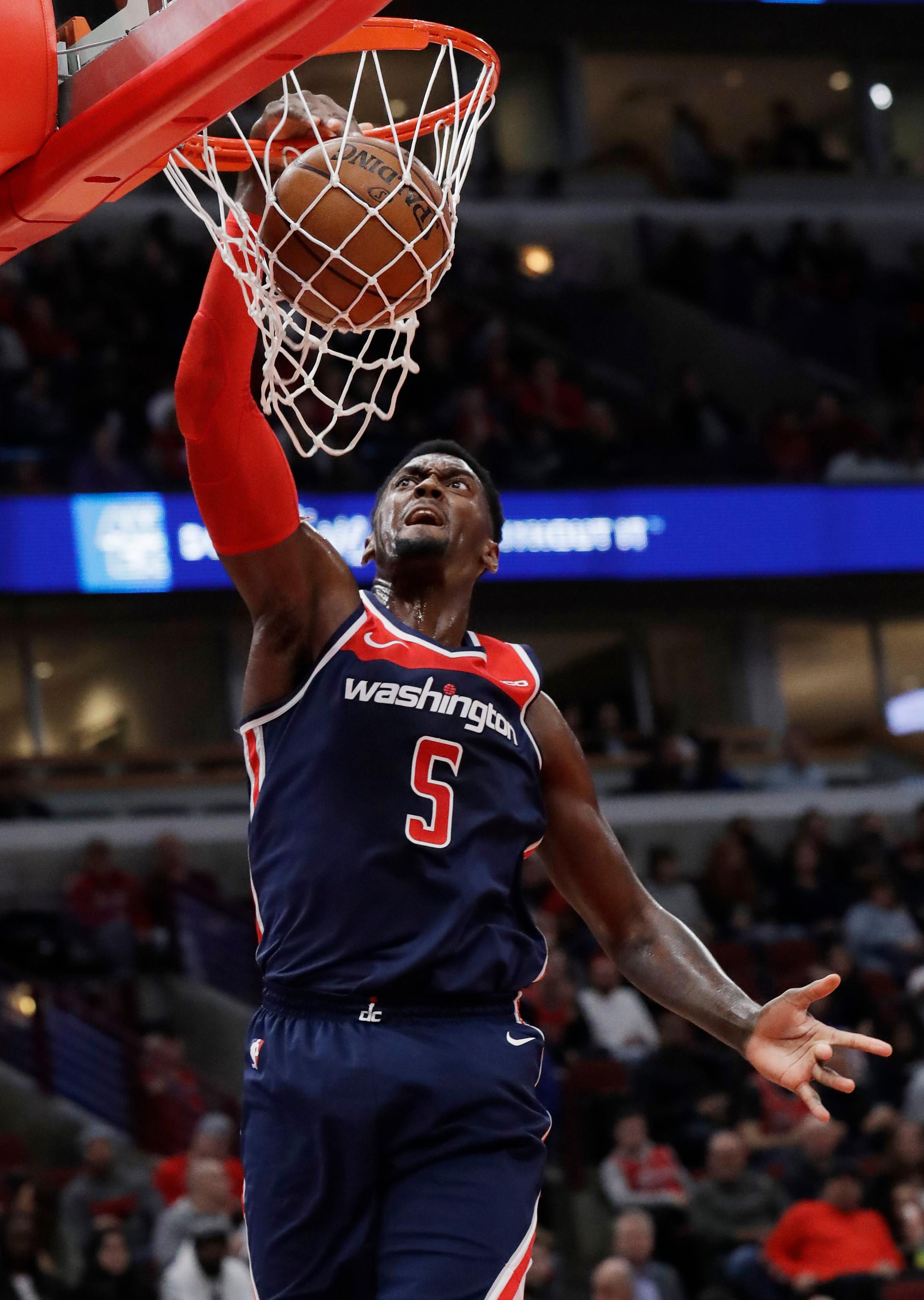 Washington Wizards forward Bobby Portis dunks against the Chicago Bulls during the first half of an NBA basketball game Wednesday, March 20, 2019, in Chicago. (AP Photo/Nam Y. Huh)