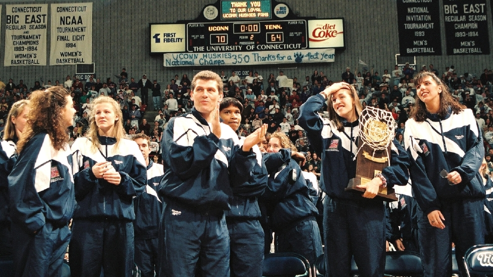Members of the UConn women's basketball team celebrate at a pep rally in their honor following their victory at the their first national championship in 1995. Among those pictured are, from left, Missy Rose, Brenda Marquis, head coach Geno Auriemma, Jamelle Elliott, Rebecca Lobo, and Kara Wolters. (Photo by Bob Stowell/Getty Images)