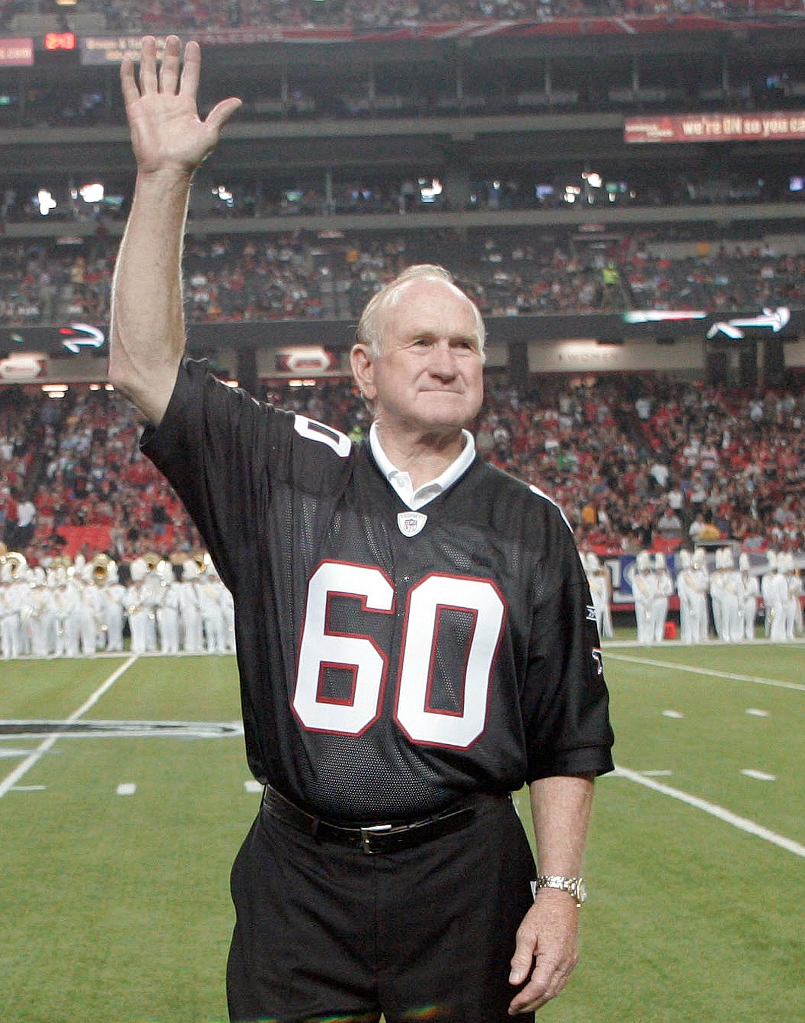 FILE - In this Sept. 20, 2009, file photo, former Atlanta Falcons Pro Bowler Tommy Nobis (60), the first player ever drafted by the franchise, is introduced along with other members of the 1966 inaugural team during halftime of an NFL football game against the Carolina Panthers in Atlanta. Nobis, the first player ever drafted by Atlanta in 1966 and a hard-hitting linebacker who went on to spent his entire 11-year career with the team, died Wednesday, Dec. 13, 2017, after an extended illness, the team announced. He was 74.  (AP Photo/John Amis, File)