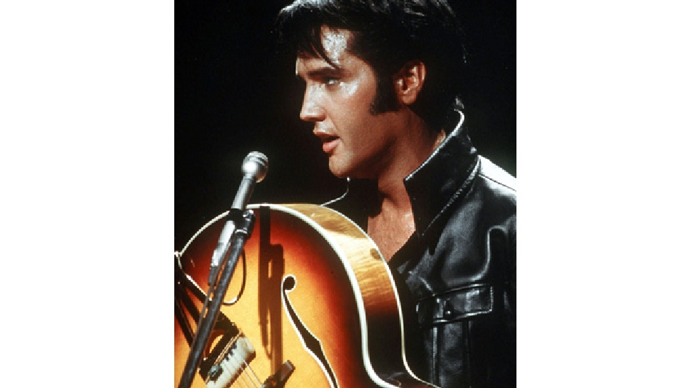 Actor/singer Elvis Presley holds his semi-acoustic guitar during a concert in the USA, in December of 1968. (AP Photo)