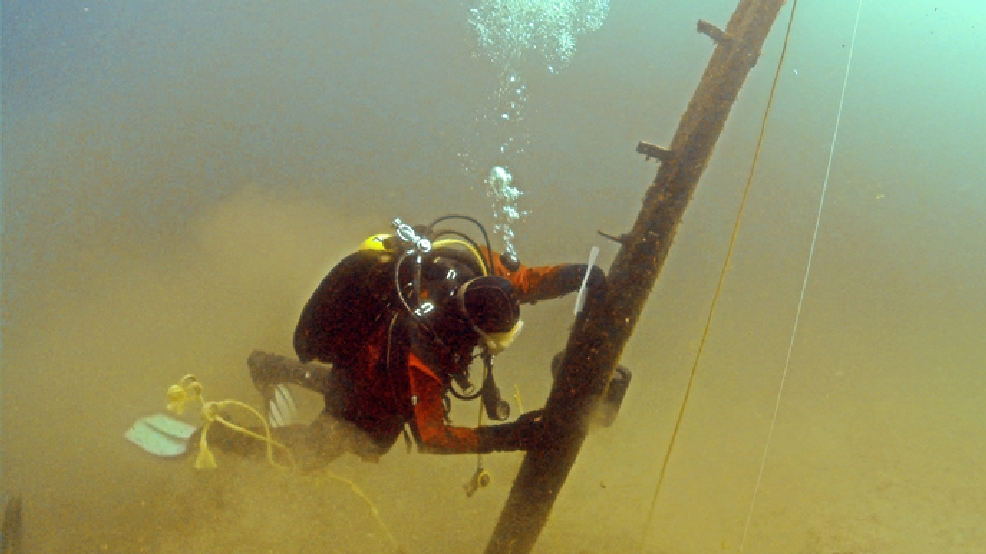 In this June 16, 2013 file photo provided by Great Lakes Exploration Group, diver Jim Nowka of Great Lakes Exploration Group inspects a wooden beam extending from the floor of Lake Michigan that experts believe may be part of Le Griffon, a ship that sank in 1679. (AP Photo/Great Lakes Exploration Group, David J. Ruck, File)