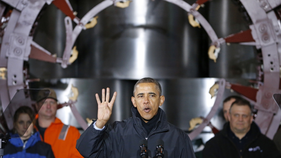 President Barack Obama gestures while talking in front of rolls of steel, Wednesday, Jan. 29, 2014, at the United States Steel's Mon Valley Works in West Mifflin, Pa. The president spoke about retirement policies he highlighted in the State of the Union address. (AP Photo/Gene J. Puskar)