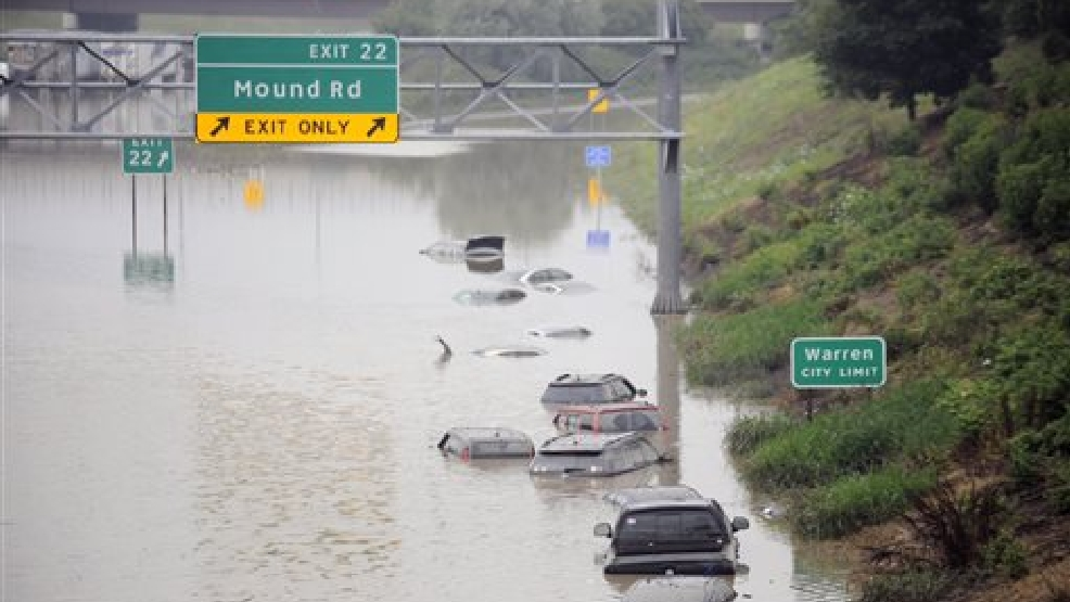 Cars are stranded along a flooded stretch of I-696 at the Warren, Mich. city limits Tuesday morning, Aug. 12, 2014. Police divers are searching for anyone trapped in their vehicles. Warren Mayor James Fouts said roughly 1,000 vehicles had been abandoned in floodwaters in the suburb where many roads were closed after 5.2 inches of rain fell Monday. (AP Photo/Detroit News, David Coates)