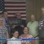 Sen. Donnelly awards medals to family of WWII vet
