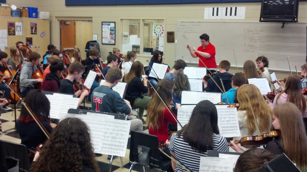 Audrey Nowak leads her orchestra class at Bay Port High School. (WLUK/Andrew LaCombe)