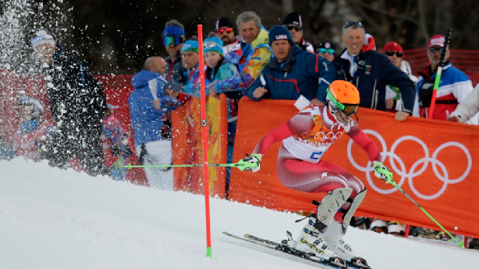 Men's supercombined gold medal winner Switzerland's Sandro Viletta finishes the slalom portion of the event at the Alpine ski venue at the Sochi 2014 Winter Olympics, Friday, Feb. 14, 2014, in Krasnaya Polyana, Russia. (AP Photo/Charles Krupa)