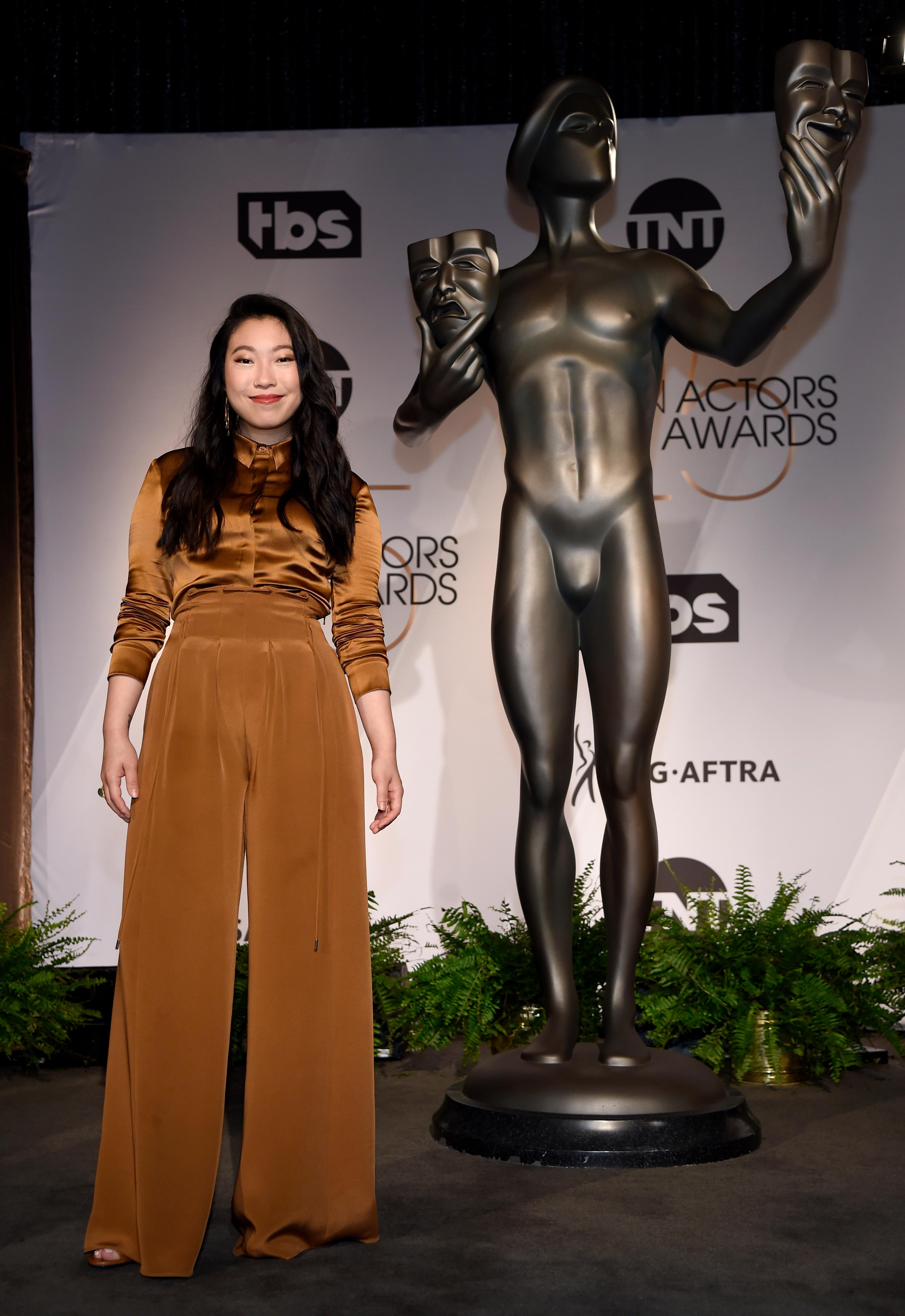 Awkwafina poses following the nominations announcement for the 25th annual Screen Actors Guild Awards at the Pacific Design Center on Wednesday, Dec. 12, 2018, in West Hollywood, Calif. (Photo by Chris Pizzello/Invision/AP)