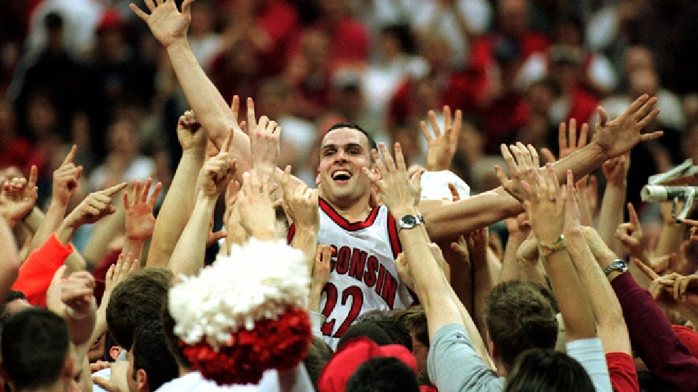 Wisconsin's Mike Kelley rides high on the shoulders of Badger fans after Wisconsin defeated 12th ranked Indiana 56-53 Sunday, March 5, 2000 in Madison. (AP Photo/Andy Manis)