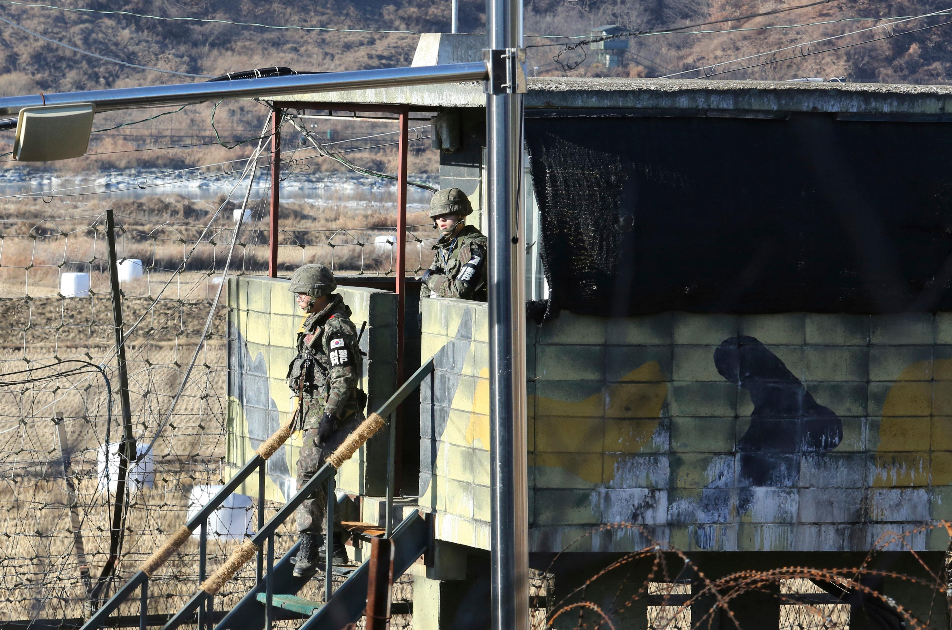 "South Korean army soldiers step down from a military guard post in Paju, South Korea, near the border with North Korea Monday, Dec. 25, 2017. North Korea on Sunday called the latest U.N. sanctions to target the country ""an act of war"" that violates its sovereignty, and said it is a ""pipe dream"" for the United States to think it will give up its nuclear weapons. (AP Photo/Ahn Young-joon)"