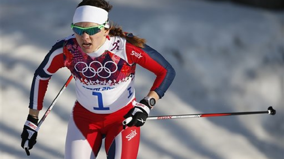 Norway's Maiken Caspersen Falla  competes to win the gold medal in the women's cross-country sprint at the 2014 Winter Olympics, Tuesday, Feb. 11, 2014, in Krasnaya Polyana, Russia. (AP Photo/Felipe Dana)