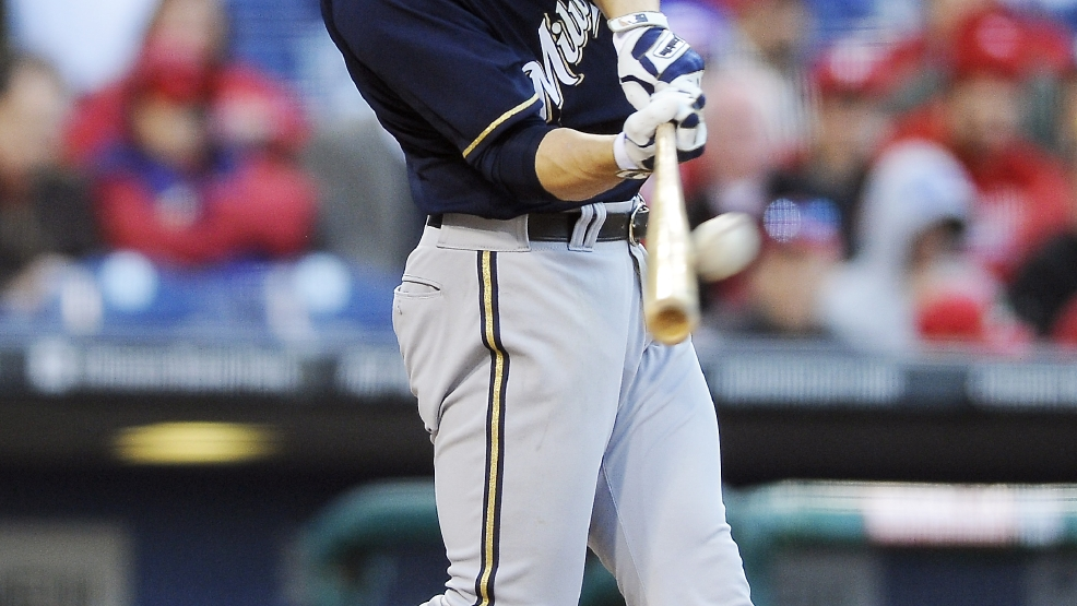 Milwaukee Brewers' Ryan Braun hits a three-run home run off Philadelphia Phillies reliever Brad Lincoln in the eighth inning of a baseball game Tuesday, April 8, 2014, in Philadelphia. The Brewers won 10-4. (AP Photo/Michael Perez)