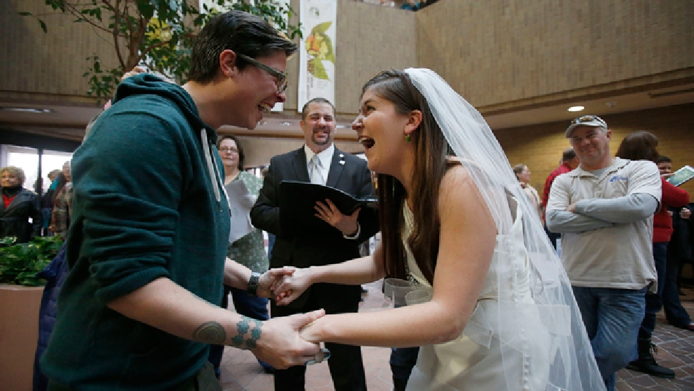 FILE - In this Dec. 23, 2013, file photo, Jax and Heather Collins get married at the Salt Lake County clerk's office, in Salt Lake City. A federal appeals court on Wednesday, June 25, 2014 ruled for the first time that states must allow gay couples to marry, finding the Constitution protects same-sex relationships and putting a remarkable legal winning streak across the country one step closer to the U.S. Supreme Court. (AP Photo/Deseret News, Ravell Call, File)