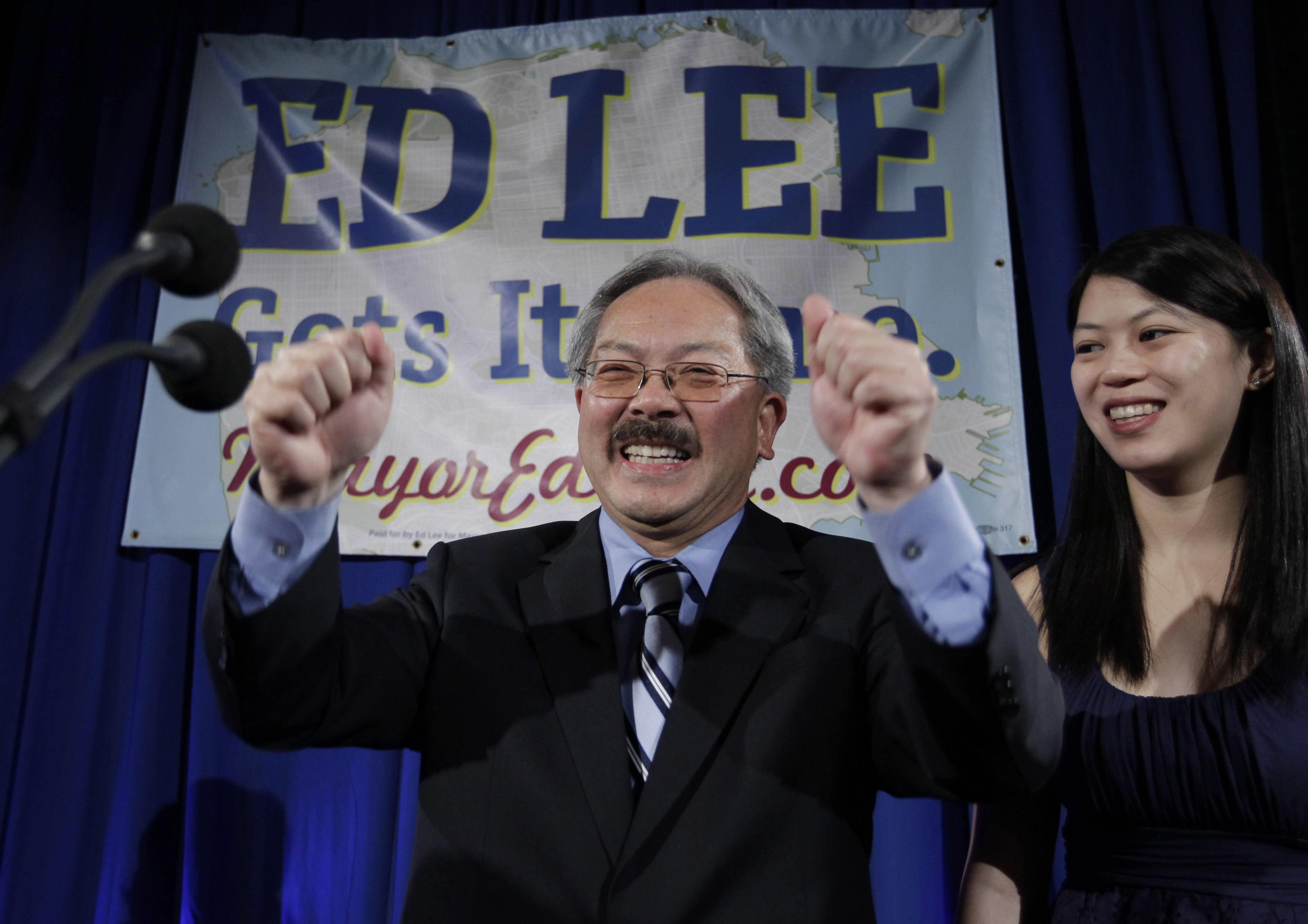 FILE - In this Nov. 8, 2011, file photo, San Francisco interim mayor Ed Lee smiles as his daughter, Brianna, right, looks on at his campaign headquarters for mayor in San Francisco, after the polls closed. The San Francisco Chronicle reported that Lee died early Tuesday, Dec. 12, 2017. He was 65.  (AP Photo/Paul Sakuma, File)