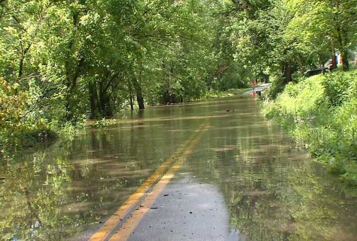 Coal River Road is submerged in water Saturday afternoon in Tornado. (WCHS/WVAH)