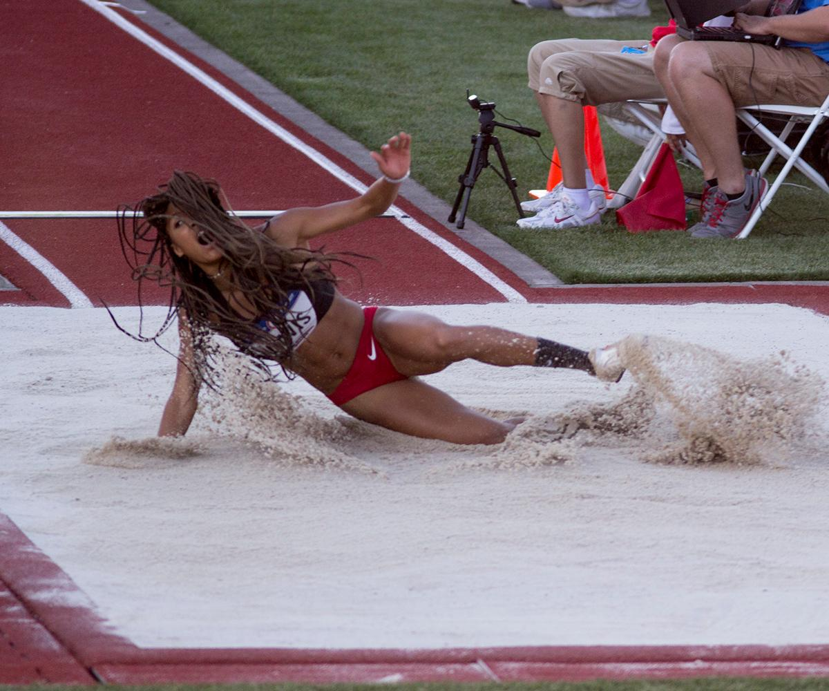 Plyometric Fusion�s Tara Davis lands in the sand pit while competing in the Women�s Long Jump. Davis placed 19th overall. Day one of the U.S. Olympic Trials began on Friday at Hayward Field in Eugene, Ore. And will continue through July 10. (Photo by Amanda Butt)