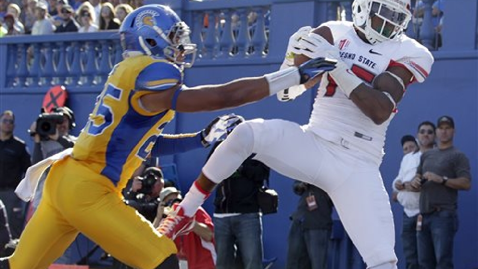 Fresno State wide receiver Davante Adams (15) catches a touchdown pass over San Jose State cornerback Akeem King (25) during the first half of an NCAA college football game on Friday, Nov. 29, 2013, in San Jose, Calif. (AP Photo/Tony Avelar)