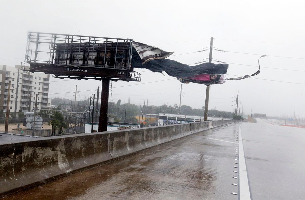 A billboard is ripped apart by high winds along Interstate 95 Northbound as Hurricane Irma passes by, Sunday, Sept. 10, 2017, in Miami. (AP Photo/Wilfredo Lee)