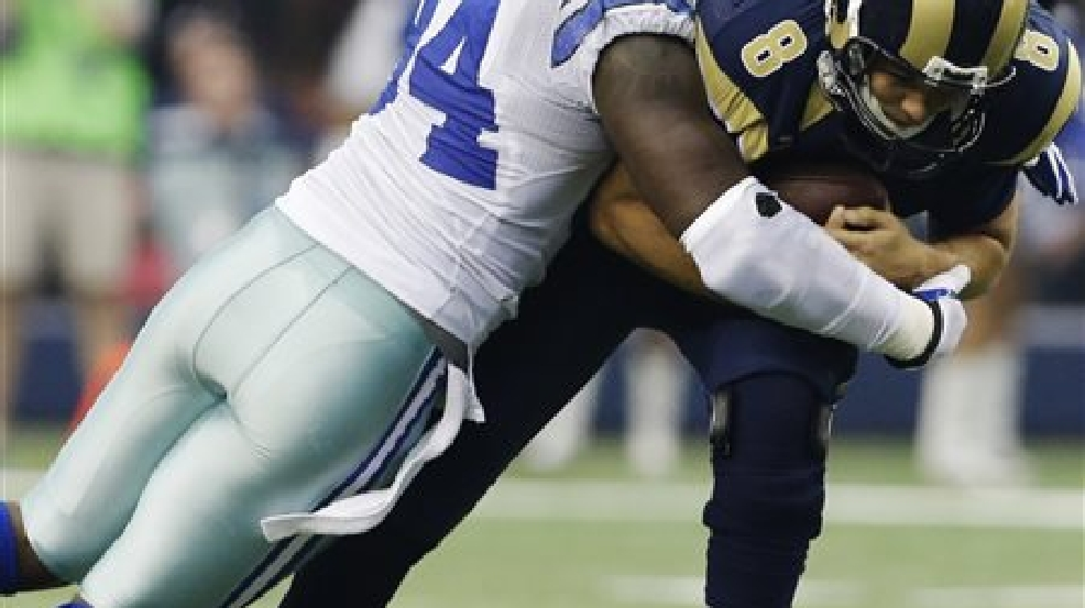 File - In this Sept. 22, 2013, file photo, Dallas Cowboys defensive end DeMarcus Ware (94) sacks St. Louis Rams quarterback Sam Bradford (8) during the third quarter of an NFL football game, in Arlington, Texas. The Cowboys are releasing franchise sacks leader Ware to save salary cap room after the worst season of his career. (AP Photo/LM Otero, File)