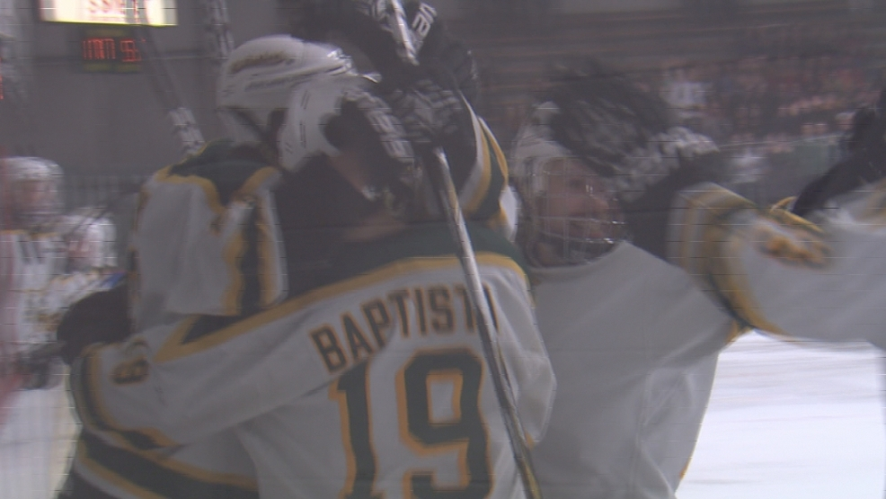 Joe Perry of St. Norbert celebrates with teammates after scoring a goal.