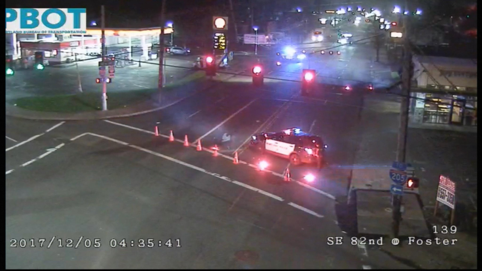 Police officers blocked the intersection of SE 82nd and SE Foster Rd. the morning of Tuesday, Dec. 5, 2017. They say a suspect drove a stolen vehicle into a power pole and fled the scene. ODOT photo{&amp;nbsp;}<p></p>