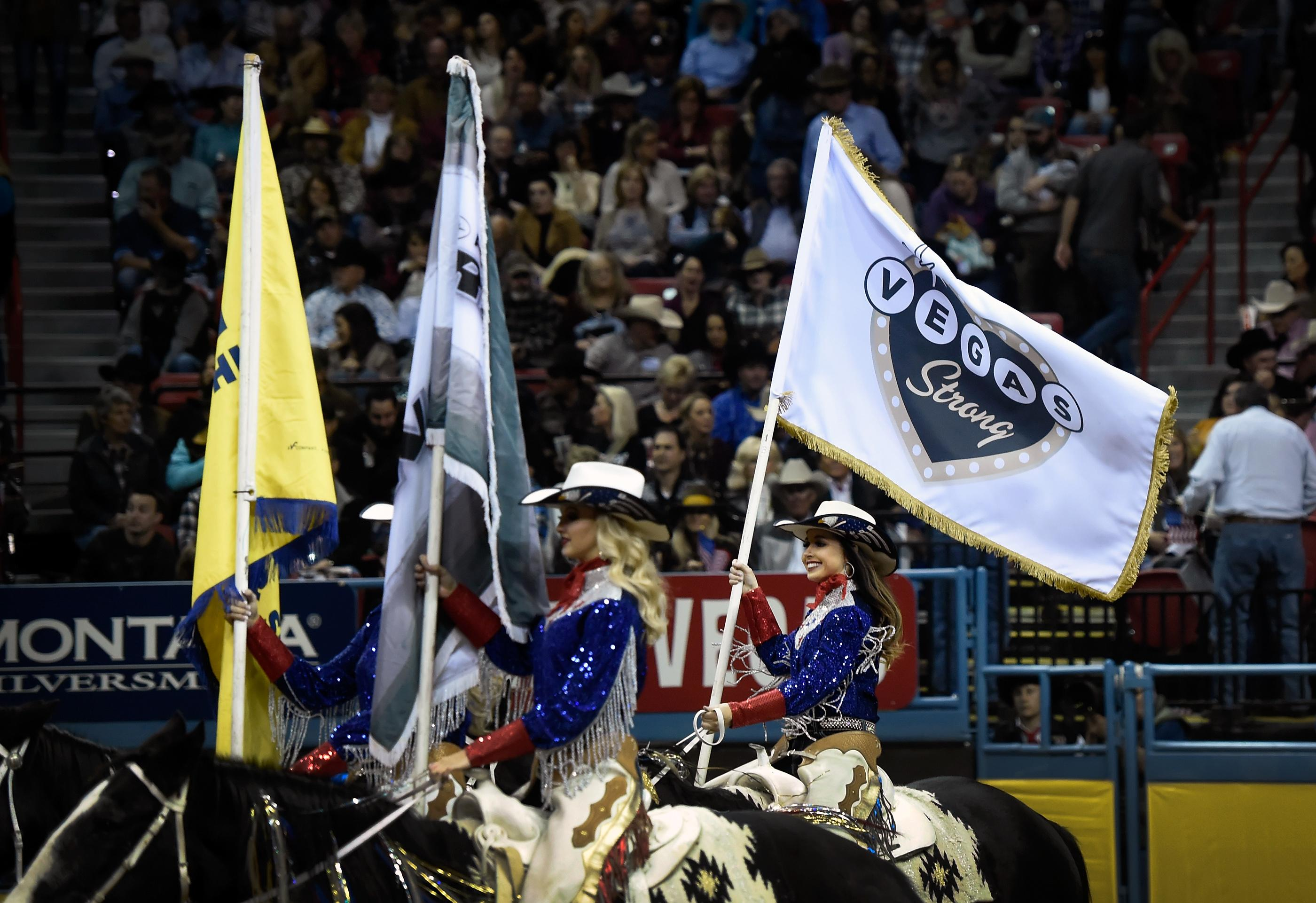 A Vegas Strong flag is carried into the arena during the seventh go-round of the National Finals Rodeo Wednesday, Dec. 13, 2017, in Las Vegas. CREDIT: David Becker/Las Vegas News Bureau