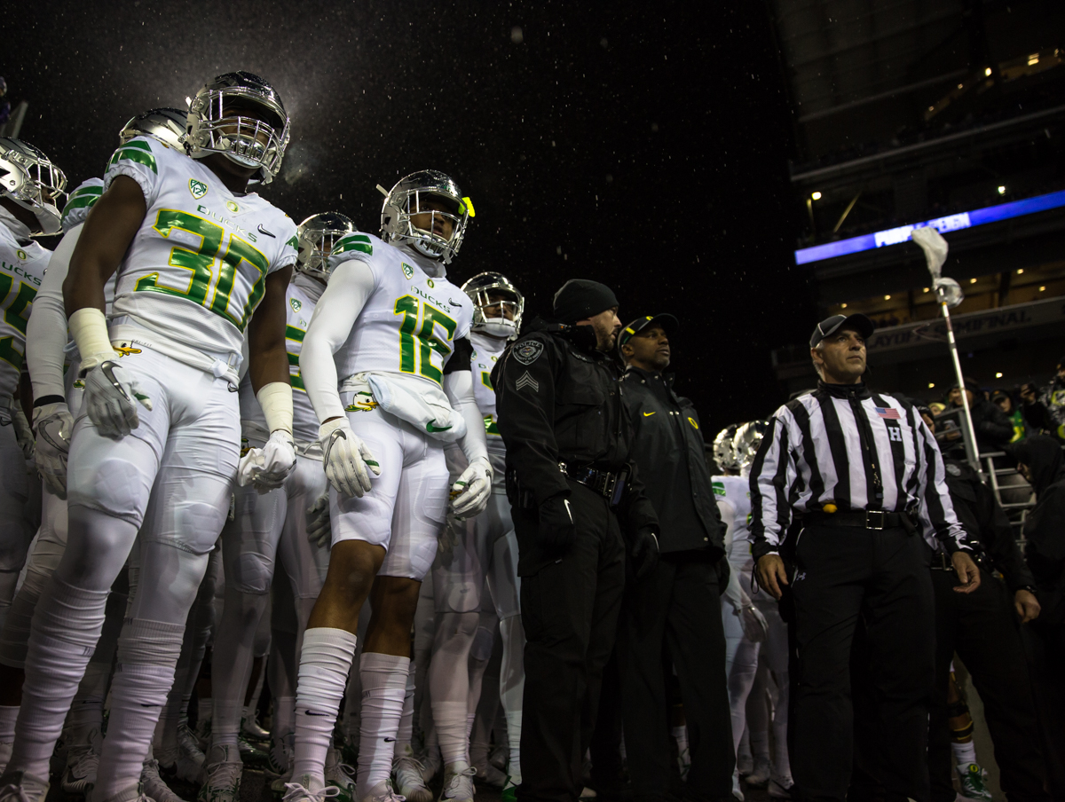 The Oregon Ducks prepare to take the field at Husky Stadium. The Oregon Ducks are trailing the Washington Huskies 3 - 17 at halftime.  The Huskies rallied with a 17-point second quarter after a slow first quarter on a cold and rainy night in Seattle, Washington.  Photo by Austin Hicks, Oregon News Lab