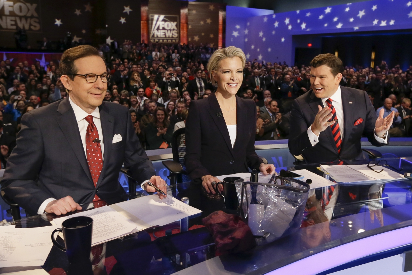 FILE - In this Jan. 28, 2016 file photo, FOX News debate moderators Chris Wallace, from left, Megyn Kelly and Bret Baier wait for the start of the Republican presidential primary debate in Des Moines, Iowa. Anticipating another appearance on a debate stage with Donald Trump, Kelly says their public feud hasn't affected her preparation and she doesn't expect a renewal of hostilities with the Republican presidential front runner. She is moderating a debate with colleagues Bret Baier and Chris Wallace, Thursday, March 3, at Detroit's Fox Theater from 9 to 11 p.m. ET. (AP Photo/Charlie Neibergall, File)