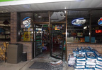This photo released by the Menasha Police Dept. shows damage to the front doors of JS Foods after a burglary Jan. 28, 2018.