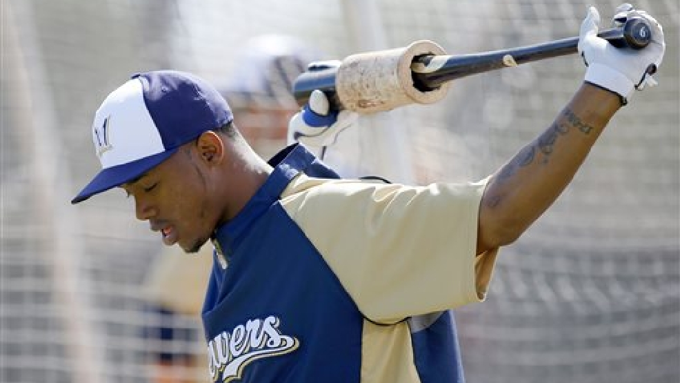 Milwaukee Brewers' Jean Segura stretches out before his turn during batting practice during spring training baseball practice, Wednesday, Feb. 26, 2014, in Phoenix. (AP Photo/Ross D. Franklin)