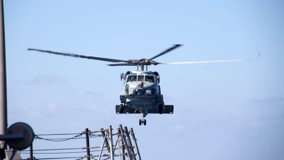 A U.S. Navy helicopter departs from the USS Pinckney to aid in the search and rescue efforts for the missing Malaysian airlines flight MH370 in the Gulf of Thailand, Sunday, March 9, 2014. The plane, which was carrying 239 people, lost contact with ground controllers somewhere between Malaysia and Vietnam after leaving Kuala Lumpur early Saturday morning for Beijing. (AP Photo/Navy Media Content Service)