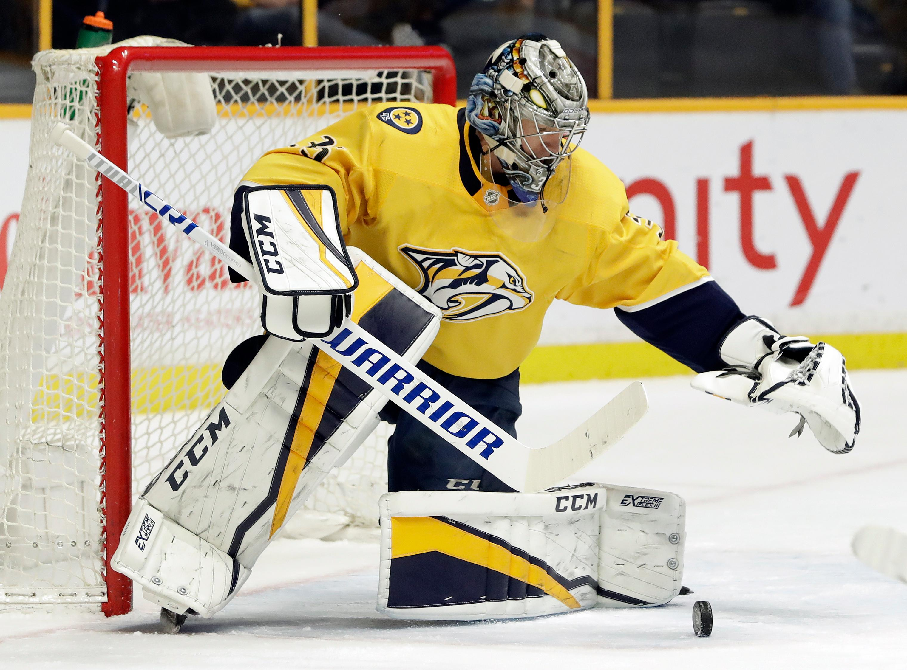 Nashville Predators goalie Pekka Rinne, of Finland, blocks a shot against the Dallas Stars in the first period of an NHL hockey game Tuesday, March 6, 2018, in Nashville, Tenn. (AP Photo/Mark Humphrey)
