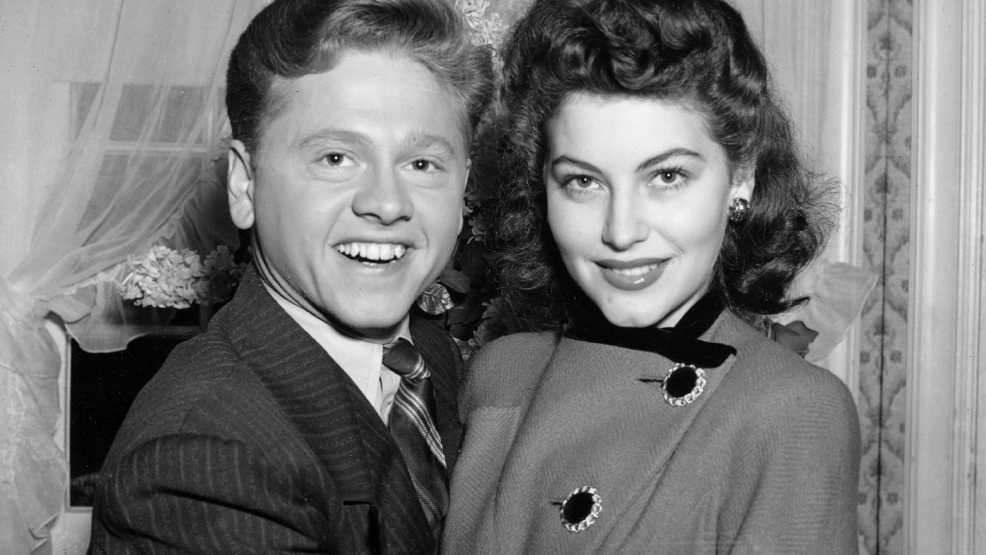 In this Jan. 5, 1942, file photo, Mickey Rooney, 21, Movieland's No. 1 box office star, and Ava Gardner, 19, of Wilson, N.C., pose together in Santa Barbara, Calif., shortly after the couple applied for a marriage license. (AP Photo/File)