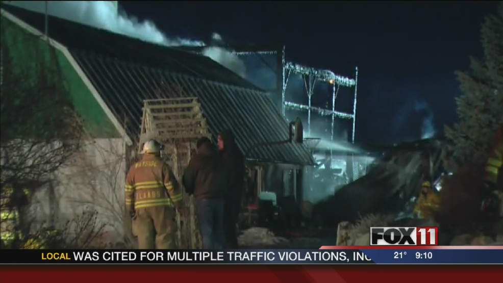 Crews battle a barn fire in the Town of Morrison early Sunday morning.