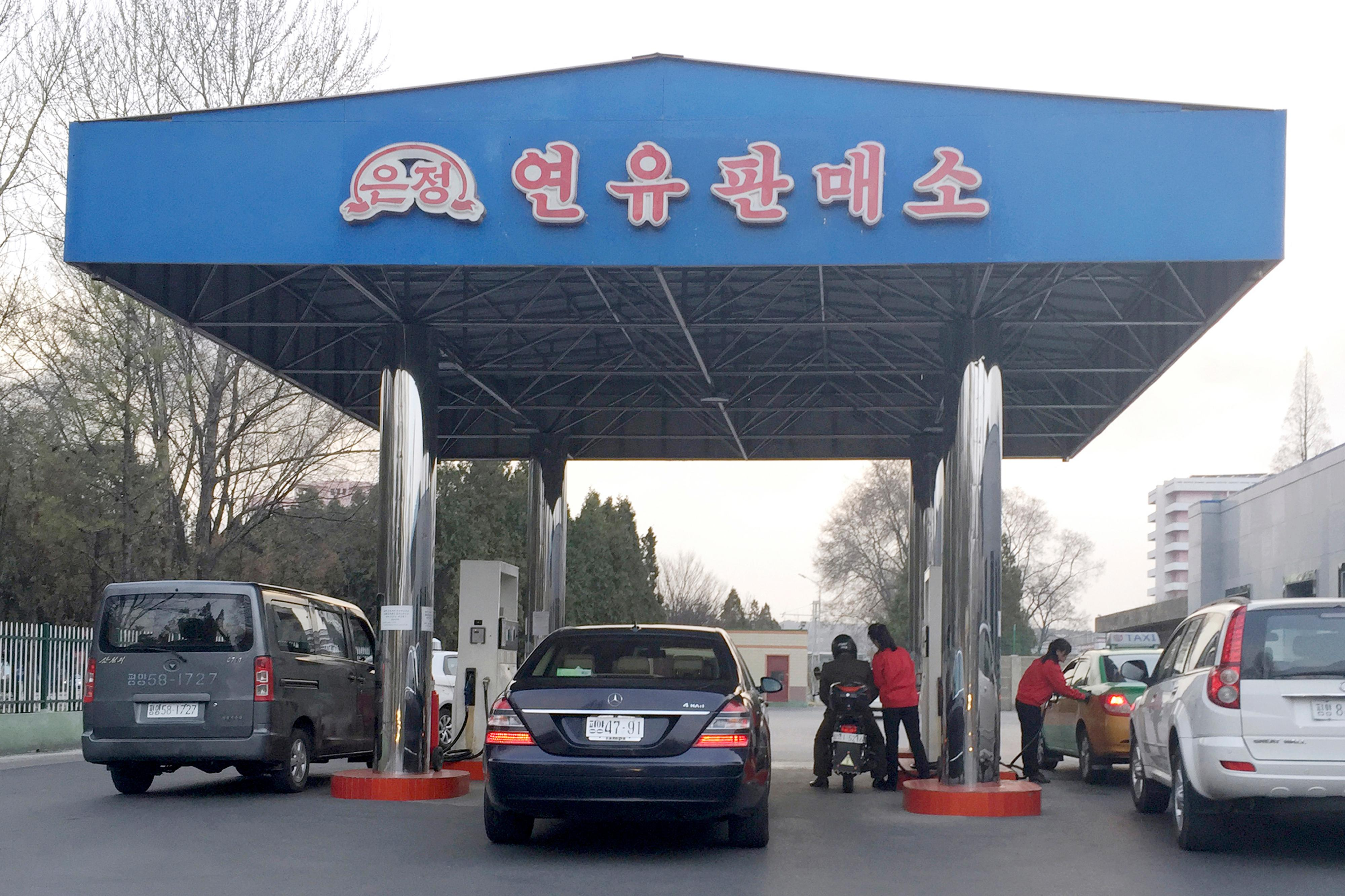 n this April 1, 2016, photo, cars line up at at a gas station in Pyongyang, North Korea. North Korea has been condemned and sanctioned for its nuclear ambitions, yet has still received food, fuel and other aid from its neighbors and adversaries for decades. How does the small, isolated country keep getting what it wants and needs to prevent its collapse? (AP Photo/Eric Talmadge, File)