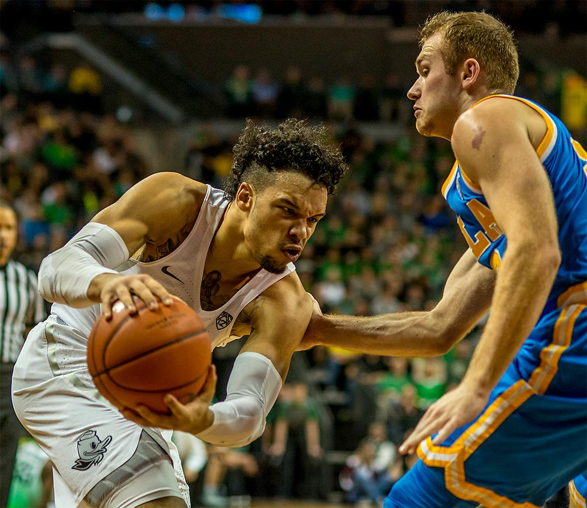 The Duck's Dillon Brooks (#24) looks for an clear path to the basket. With two seconds left in the game Dillon Brooks (#24) scored a three pointer to give them the lead, 89-87, over No. 2 UCLA and take the win on Wednesday at Matthew Knight Arena in front of a sold out crowd. Brooks finished with 23 points, Payton Pritchard (#3) added another 15 points and Jordan Bell (#1) added 13. The Ducks are now 12-2 and 1-0 in the Pac-12. Photo by August Frank, Oregon News Lab
