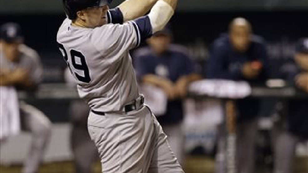 New York Yankees' Mark Reynolds doubles in the eighth inning of a baseball game against the Baltimore Orioles, Tuesday, Sept. 10, 2013, in Baltimore. Curtis Granderson scored on the play, and New York won 7-5. (AP Photo/Patrick Semansky)