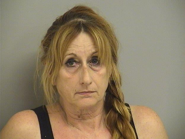 Deputies arrested Marjorie Satterfield Thursday evening. She is being booked into the Tulsa County Jail on multiple counts of animal cruelty, one count for each animal that was found inside the home. (Courtesy of Tulsa County Jail)<p></p>